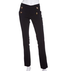 Gucci black slacks with signature gold buttons